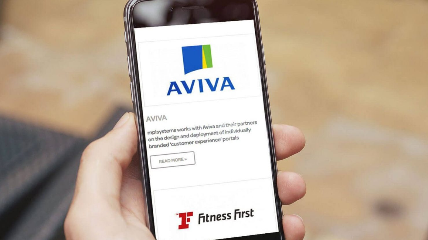 iPhone showing website design and branding for MPL Systems with Aviva and Fitness First logos
