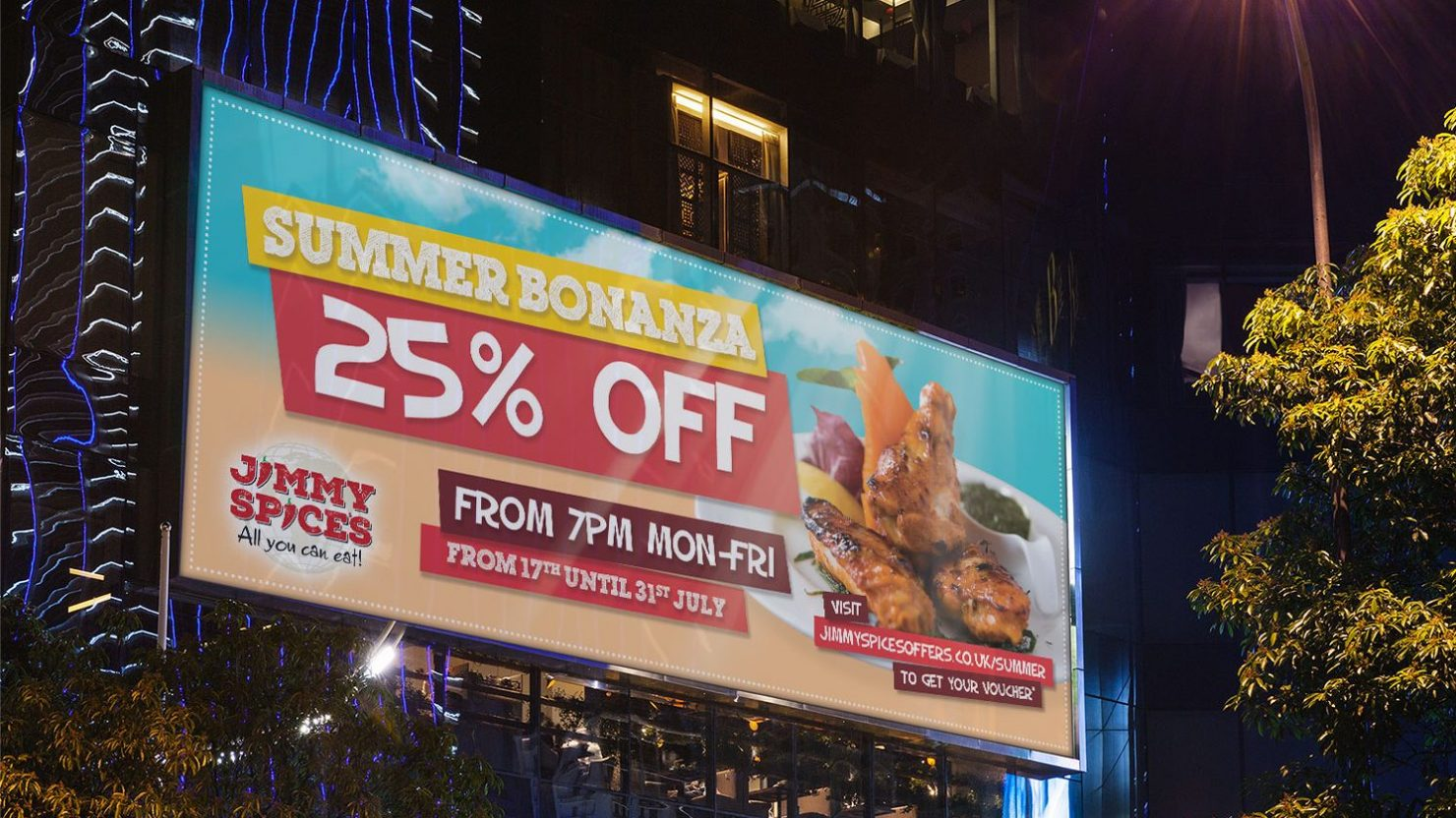 Large backlit city billboard showing promotional offer for Birmingham buffet restaurant Jimmy Spices